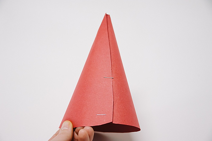 a cone made out of paper, secured with staples