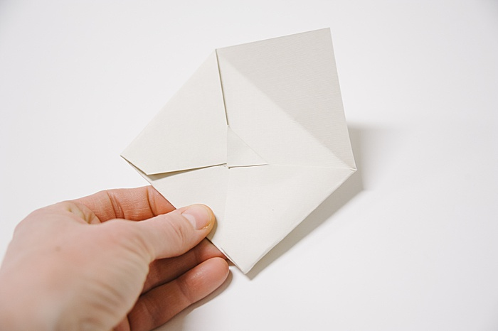 fold and glue down the small corner flap