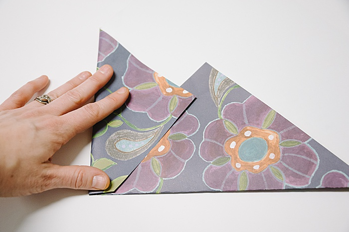 fold in left side of paper square to make an envelope
