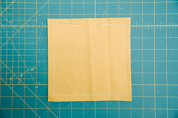 sew around perimeter of cornhole bag squares with a 1/2 inch seam allowance
