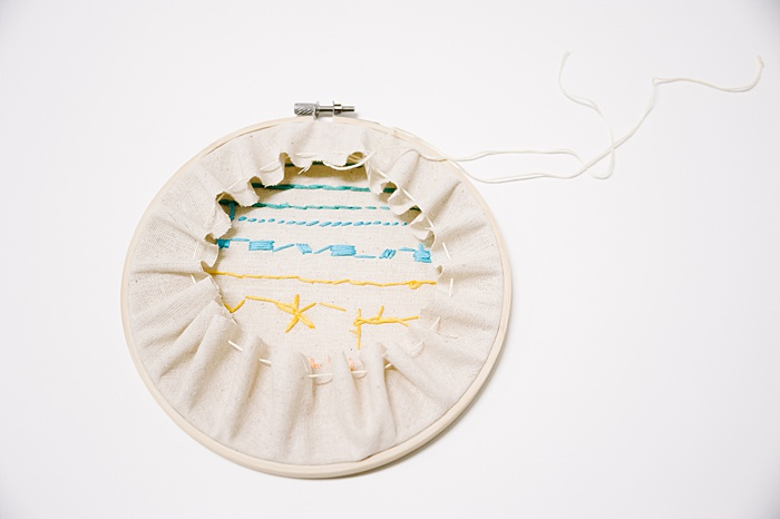 pull the tails of the running stitch and watch the back of the embroidery tighten up