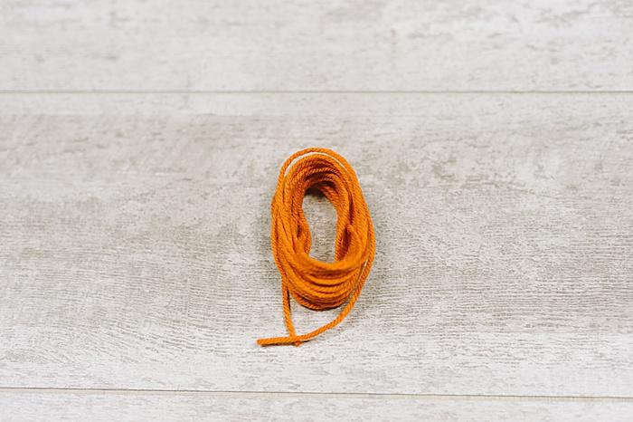 slide the yarn tassel off your hand