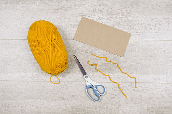 supplies for making tassels with cardboard
