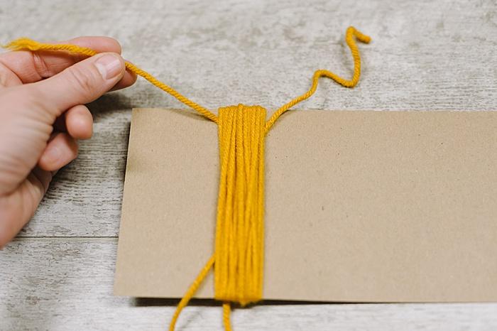 slip a tassel tie string under the bundle, tie loosely at top.