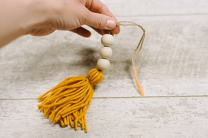 add wooden beads to Christmas tassel