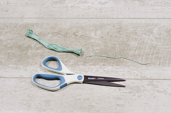cut two 10 inch sections of embroidery floss
