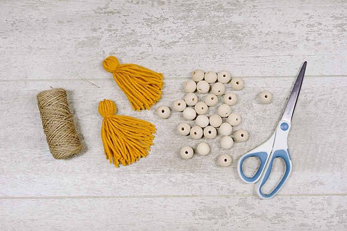 how to make a wood bead garland with tassel ends