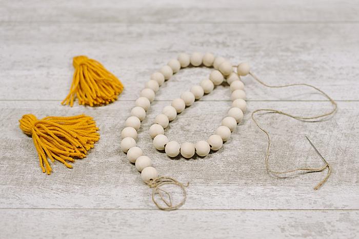 add wood beads to make a garland