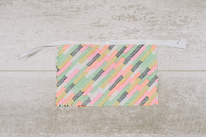 sew around edges to create a small zipper pouch