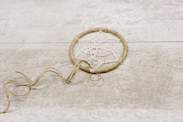 add twine tails to the bottom of the dream catcher