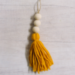 how to make a yarn tassel and wooden bead ornament