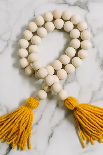 How to Make a Wood Bead Garland with Yarn Tassels